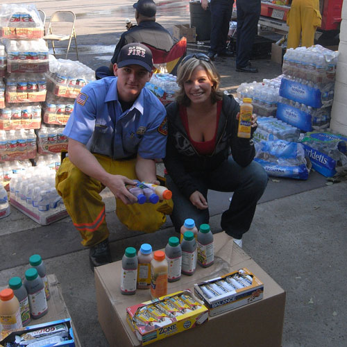 Roseanna Wheeler with firefighter and juice
