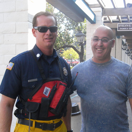 Dr. Klein posing with firefighter