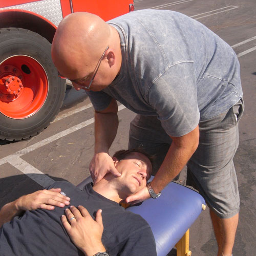 Dr. Klein adjusting firefighters neck
