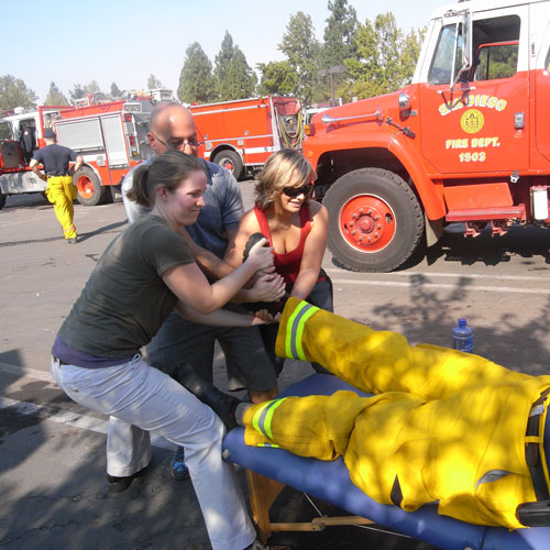Dr. Klein, Roseanna, and Amanda all pulling the firefighters leg