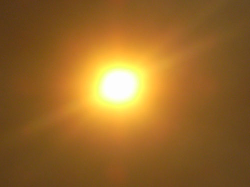picture of sun with smoke