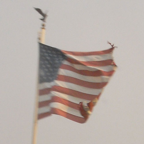 flag ripped by wind